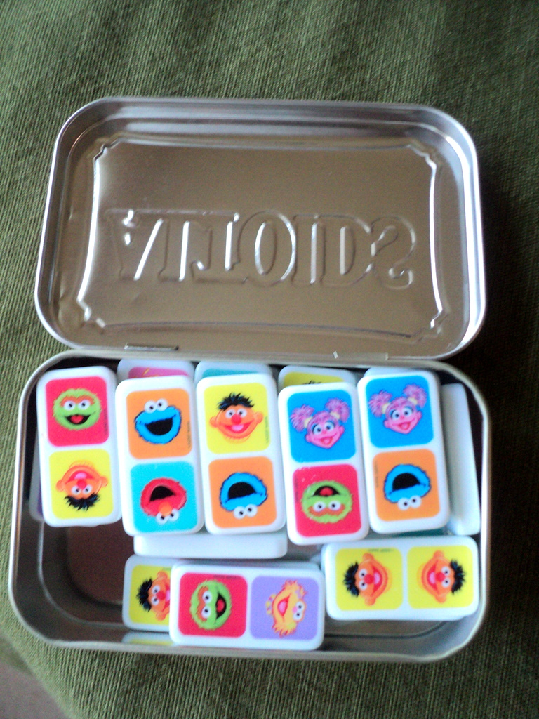 dominoes in a tin