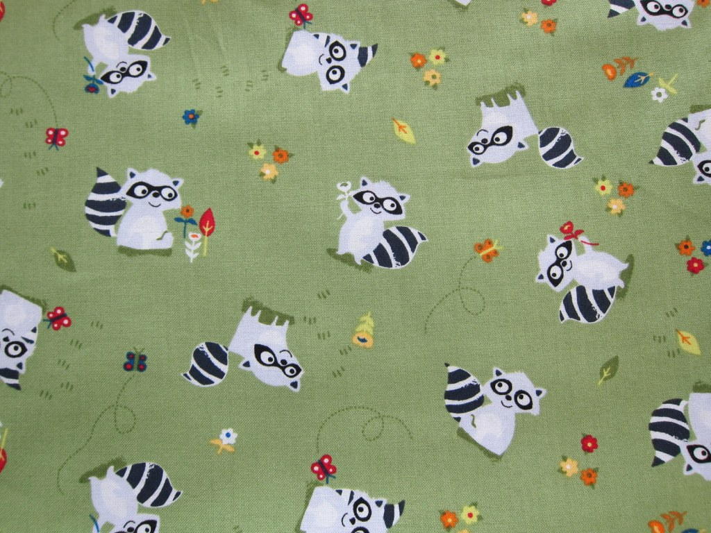 racoons in green