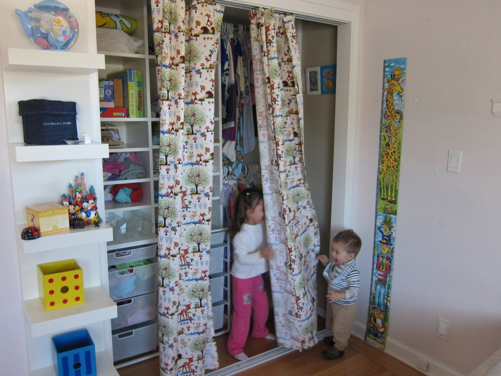 kids playing in curtains