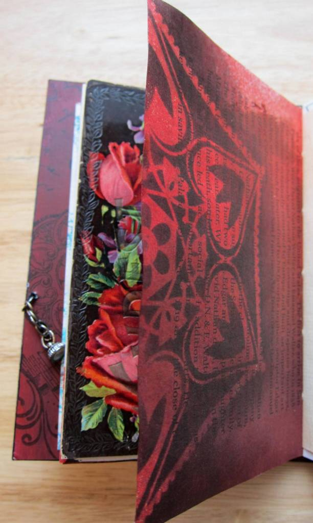 red stencil and postcard